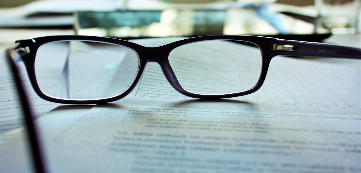 image of spectacles sitting on papers